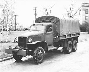 """GMC 2.5 ton Truck was the workhorse of the US Army in WW2. Many strategists believe logistics win wars and this truck made American success possible. GM made 812,000 of these trucks during WW2 compared to 100,000 of the similar truck by the Germans who were forced to rely on horses instead. The versatile truck was made into a number of versions including fuelers, cargo haulers, troop transports, ambulances and more. Heavier modern versions are still made today as the M35 """"deuce and a half""""."""