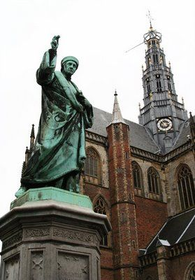 Statue of Laurens Janszoon Coster, Grote Markt, Haarlem, the Netherlands. In his hand he is holding the letter A. Laurens Janszoon Coster (ca. 1370, Haarlem, the Netherlands – ca. 1440), was long thought to be the inventor of the printing press, but actually Johannes Gutenberg from Germany was the one who invented this.