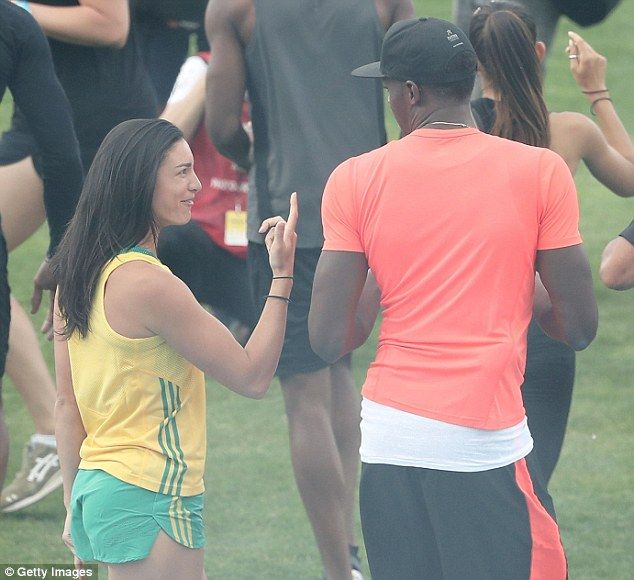 Whose number one? Michelle Jennekegestures to Usain Bolt during the Nitro Athletics meet in Melbourne