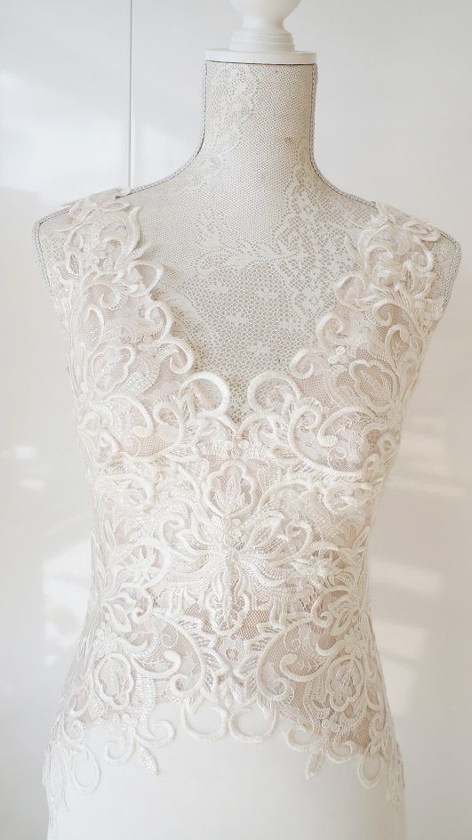 Scuba wedding dress with lace bodice and v-shaped open back.