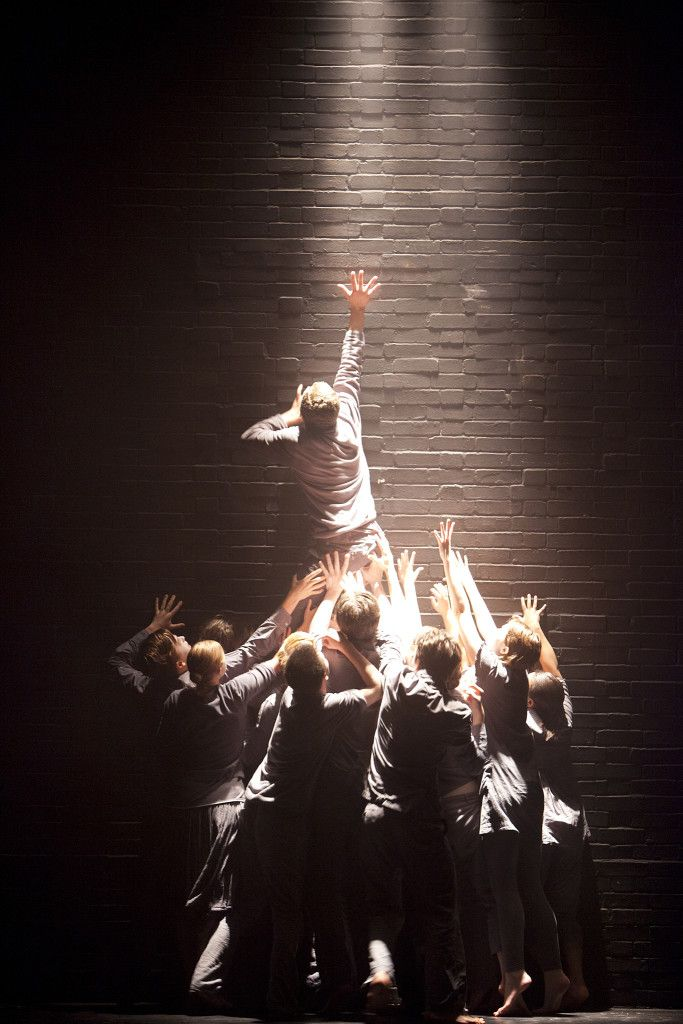 Angle The angle of the downlight focuses on the image of the boys reaching up and creates an intense feeling