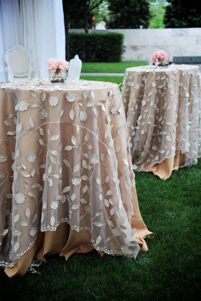Sheer overlay w/champagne underskirt adds soft detail. Simple centerpiece needed!