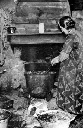 Old photograph of a crofter dyeing wool inside her cottage in Portnalong, Isle of Skye, Scotland