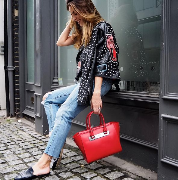 Sabrina Chakici adds a pop of chic to her rock outfit with this red leather Style Code bag.
