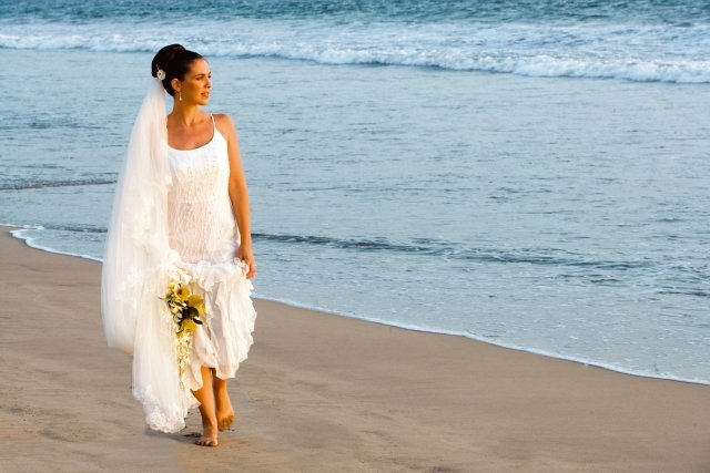 Experience the passion of a sunset wedding on the golden beach as the waves caress the shoreline.