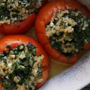 Tomatoes Stuffed with Brown Rice and Feta by saveur who suggests using firm tomatoes and a cream, less briny French feta to round out the tanginess of the tomatoes. #Tomatoes #Stuffed_Tomatoes #Veggie #saveur