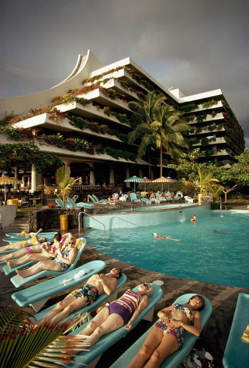 Vacationers lounge poolside at Kailua's Kona Hilton Resort in Hawaii, March 1975.Photograph by Robert Madden, National Geographic