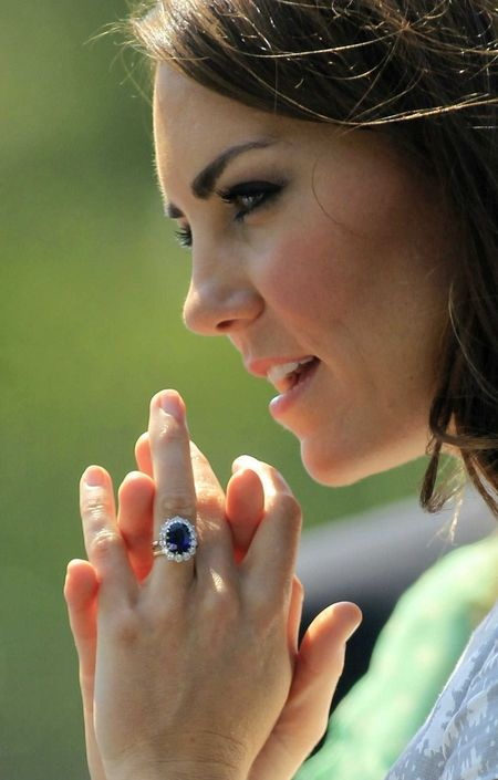 Princess Diana's /Kate Middleton's Sapphire engagement ring. Sapphire surrounded by diamonds on a platinum band. Wedding band in yellow gold (from the Queen's private gold reserve).