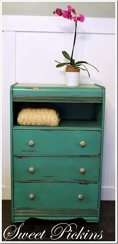 Lovely waterfall dresser - I think it looks even better with a missing drawer/shelf instead.
