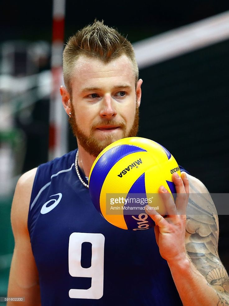 Ivan Zaytsev #9 of Italy holds a ball against Iran during the Men's Quarterfinal Volleyball match on Day 12 of the Rio 2016 Olympic Games at Maracanazinho on August 17, 2016 in Rio de Janeiro, Brazil.