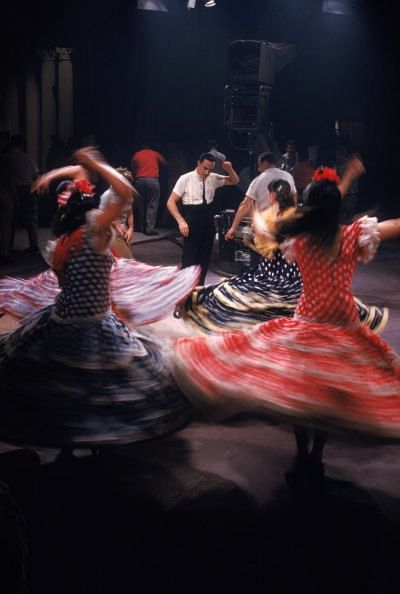 1959    Women in bright Spanish costumes perform a lively dance scene on the set of the film 'West Side Story'. (Photo by Ernst Haas/Ernst Haas/Getty Images)