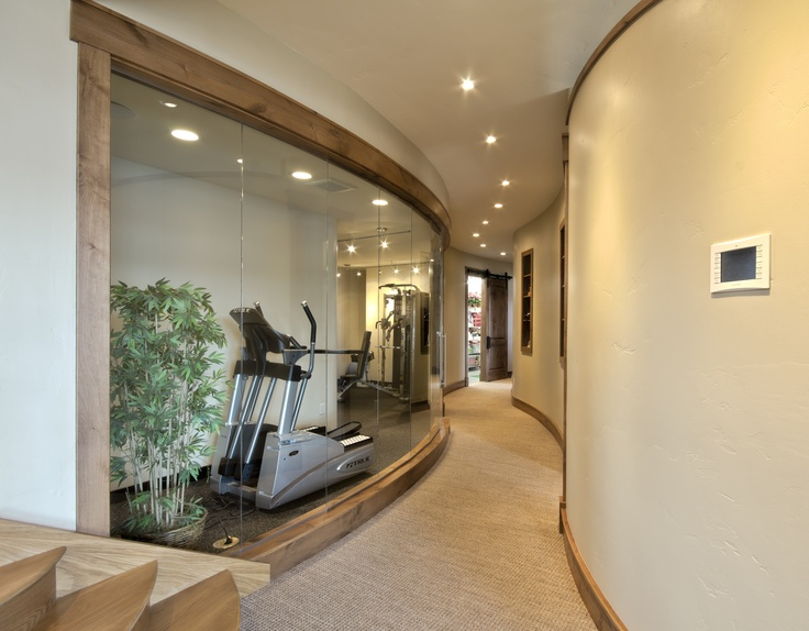Curved Glass Wall Looking Into Workout Room Georgetown