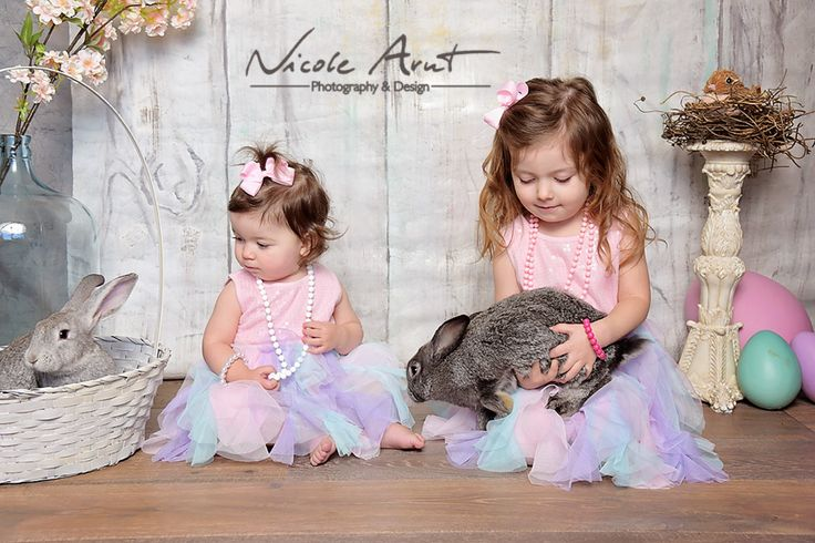 Easter Photo Idea: Love the combination of kids and bunnies, the girls outfits really add to the scene