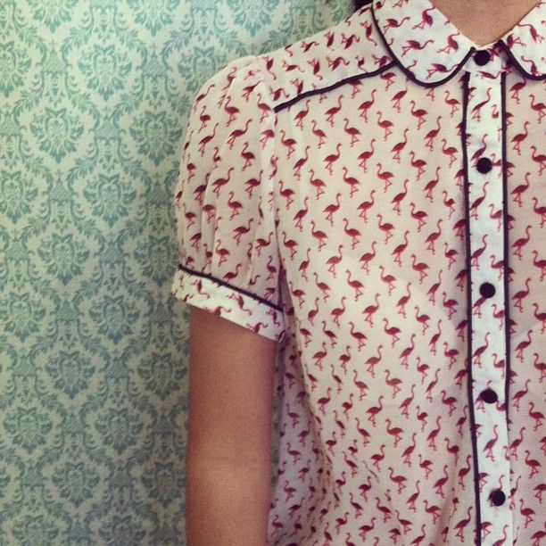 Flamingo print blouse with short puff sleeves, dark contrast piping and Peter Pan collar