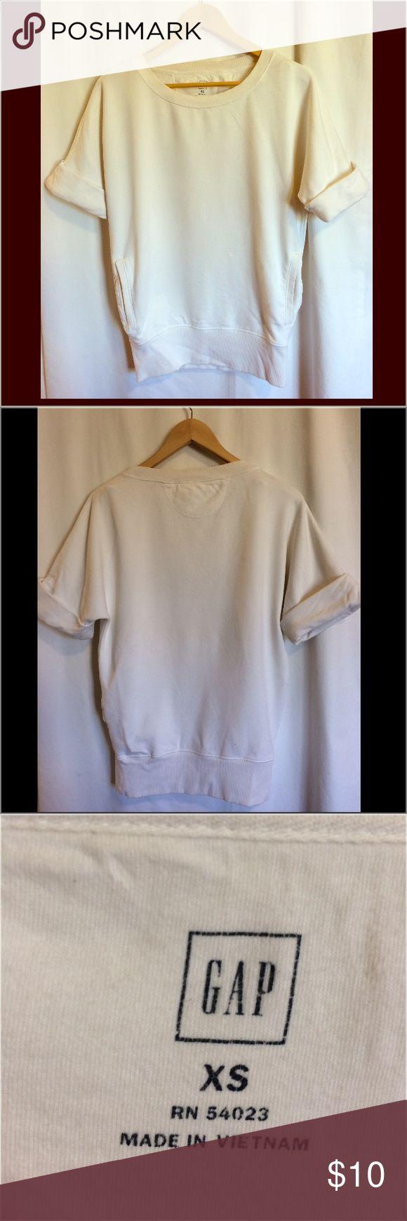 Gap Short Sleeved White Sweatshirt Short sleeved, white sweatshirt by Gap. Size XS fits up to size 6. Has pockets. GAP Sweaters