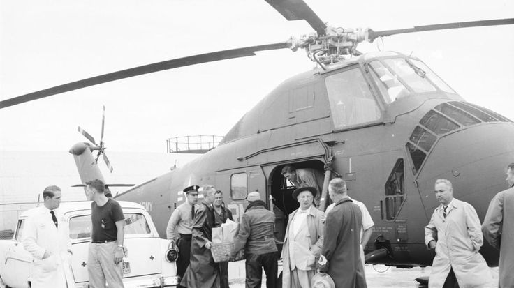 Bundles of food, blankets and cots from the Red Cross are loaded aboard an H-34 helicopter at the Sikorsky Aircraft flight field after the Flood of 55.