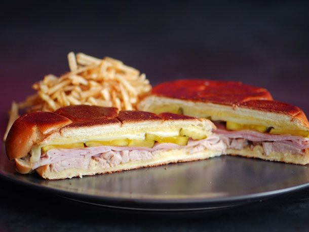 Cuban Medianoche Sandwich. Pork tenderloin, garlic, orange juice, lime juice, cumin. Yellow mustard, sweet rolls, deli ham, bread and butter pickles, swiss cheese.