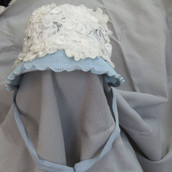 Vintage mid-century toddler Easter bonnet - blue with white flowers.