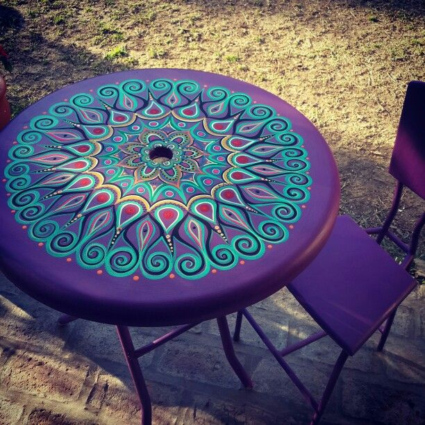 Purple and turquoise table with purple chairs.