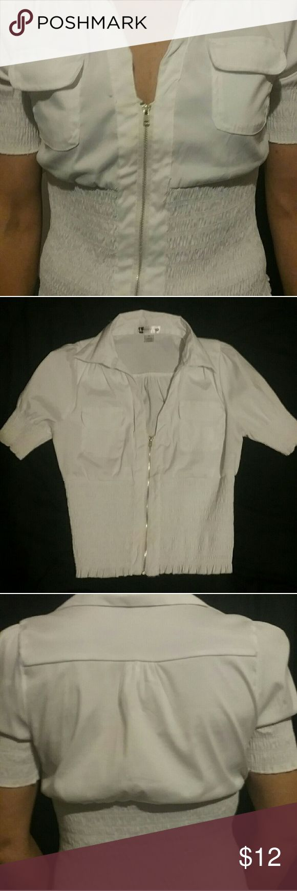 A white zip-up women's blouse size medium A white blouse that  zips up in the front size medium; it bunches on the end of the sleeves and from the start of the stomach down Tops Blouses