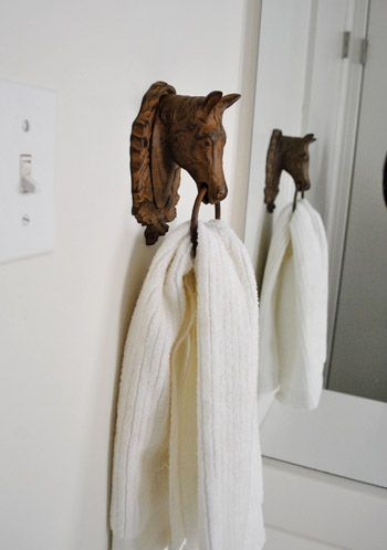 use a door knocker as a towel holder. Pure genius. A great way to add a little quirkiness.