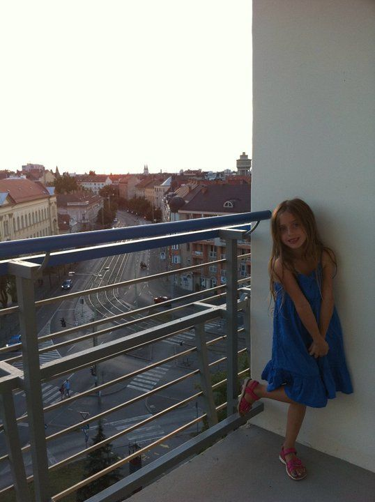 The baby of the family, Isabella, posing on the balcony of our hotel!