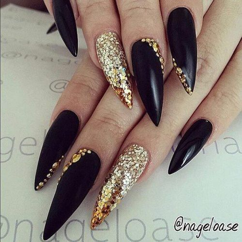 Image via We Heart It #blackandgold #chic #fashion #nails #trend #unique #goldsparkles #pointy