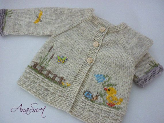 Hand knitted baby cardigan with decoration.Knitted baby by AnaSwet