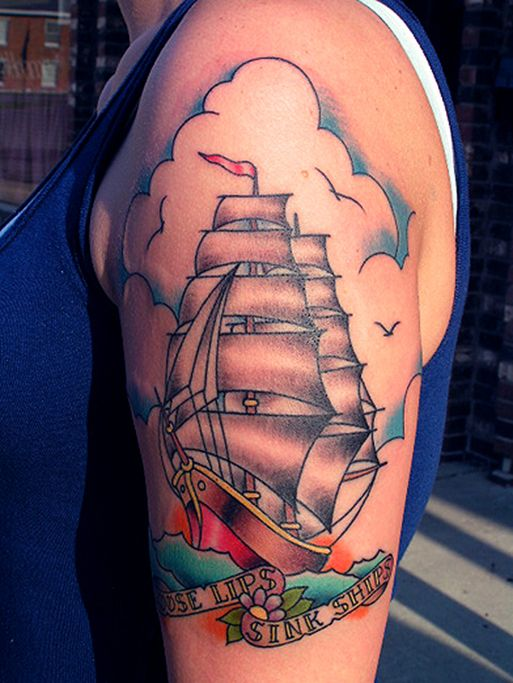 From website tattoodonkey.com. TOTALLY jealous of this tattoo. Minus the flower and the clouds I like the Sailor Jerry style ship. One day I will be getting one of these!