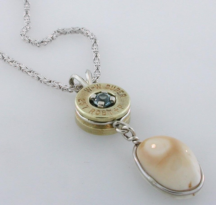 14K white gold Elk Ivory pendant with a Montana Blue Sapphire in a bullet casing.
