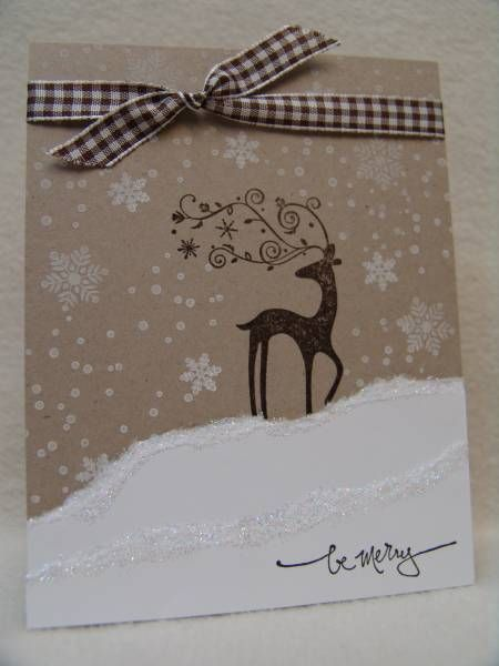 christmas card with stamped reindeer, white paper and stamps on kraft cardstock