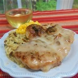 Pork chops are coated with seasoned Italian crumbs and baked with an easy mushroom and wine sauce for for a nice weeknight dinner that practically takes care of itself.