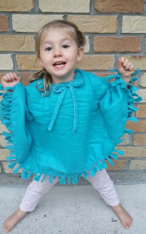 Make a poncho in an Hour….. Honestly, that's all it takes! What you need: One Fleece Blanket, throw or square of fleece material. (I got a Woolworth's fleece blanket for $7) Scissors. Yep, that's all!  How to Make: Firstly