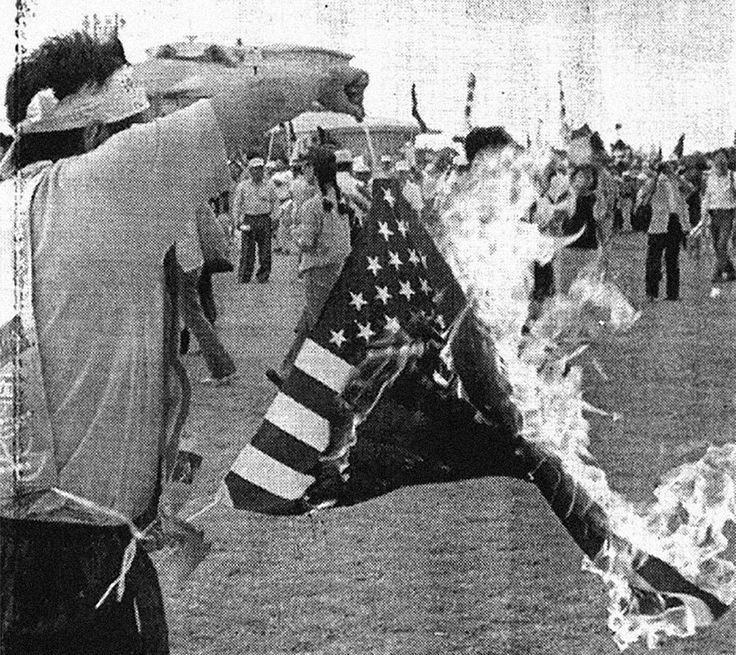 October 22, 1995: Protestors set an American flag on fire and demand the closure of the U.S. military base in Okinawa where three U.S. servicemen abducted, beat, and raped a 12-year-old Japanese girl. The men served terms in Japanese prisons and were released by 2003.