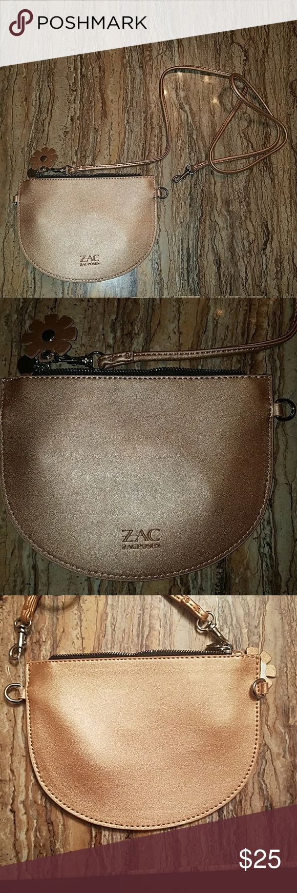 Zac Posen crossbody/clutch purse Zac Posen for Bloomingdales rose gold crossbody with detachable strap. Can be used as a clutch 6 inches long 4 inches tall. Brand new. Smoke free home. Zac Posen Bags Crossbody Bags