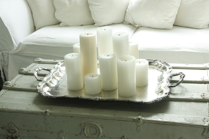 love white candles on silver trays... on the list for the living room fireplace