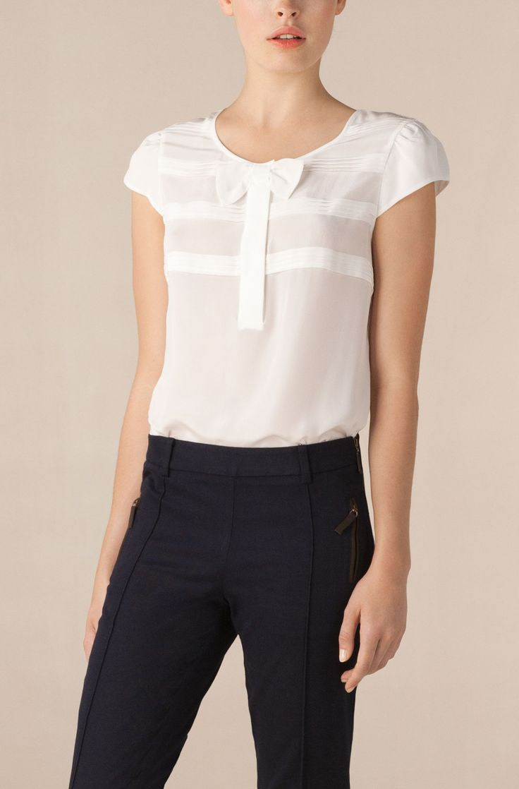 white silk bow blouse tucked into tailored trousers....love how simple and feminine this is