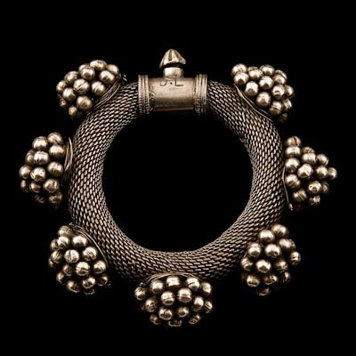 EHTNIC: Ethnic jewelry highlights the work of cultures around the world. A specific culture's jewelry is identifiable by the materials used, the methods of construction, and the symbology that is often inherent in the work.  Silver Bracelet. Rajasthan. India. c. 1920