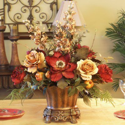 Magnolia & Rose Silk Floral Centerpiece AR246-85 - Gorgeous hand-wrapped burgundy magnolias, soft gold roses, snapdragons, and pomegranates add just the right touch to this elegant silk floral centerpiece. Displayed in an antique gold-finish, scalloped resin vase. #silkroses
