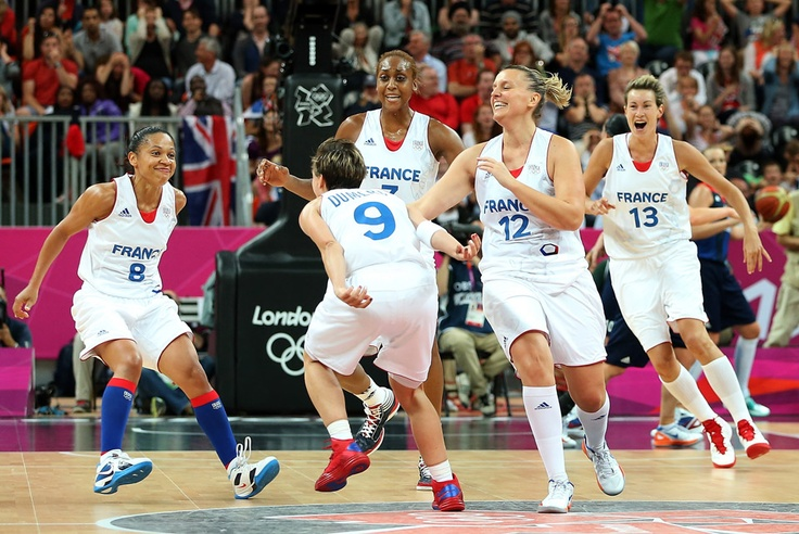 London 2012 - Edwige Lawson-Wade #8, Celine Dumerc #9, Sandrine Gruda #7, Marion Laborde #12 and Elodie Godin #13 of France celebrate after Dumerc hit the game winning basket in the final moments of overtime en route to defeating Great Britain in the Women's Basketball Preliminary Round match on Day 7 of the London 2012 Olympic Games at Basketball Arena on August 3, 2012 in London, England.  Getty