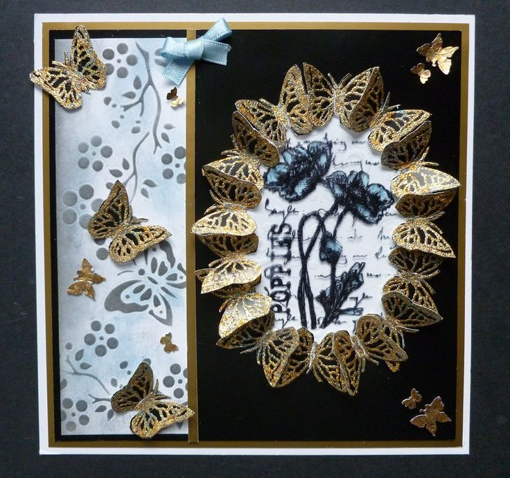 'Butterflies and Poppies' card - Imagination Craft's -Gold & Black shiny card.  Poppies stamp set.  Butterfly border stencil.  Magi-bond glue.  Forest glade Gilding flakes.  Gilding glue.  Swirls embossable.   Black ink pad.   Black Stazon pad.  Acetate,  Distress inks  Tiny butterfly punch - Tonic.   Medium butterfly punch.  Oval die.  February 2013.   Designed by Jennifer Johnston.