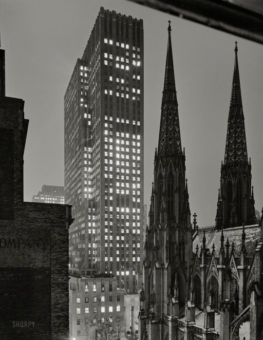 """December 5, 1940. """"Joseph Mullen Inc., 18 E. 50th Street, New York. View from window."""" Taking in the spires of St. Patrick's Cathedral and, across Fifth Avenue, Rockefeller Center's International Building at 45 Rockefeller Plaza. Large-format acetate negative by Gottscho-Schleisner."""