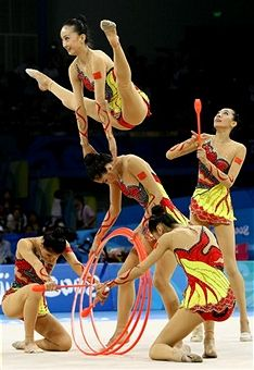 The Chinese team perform in the 3 Hoops and 2 Clubs rotation in the Group All-Around Final held at the Beijing University of Technology Gymnasium during Day 16 of the Beijing 2008 Olympic Games on August 24, 2008 in Beijing, China.