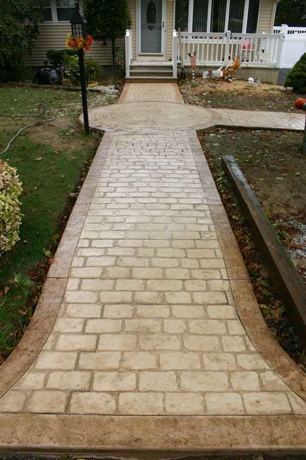 Stamped Concrete - Old English Cobblestone with acid stained textured borders