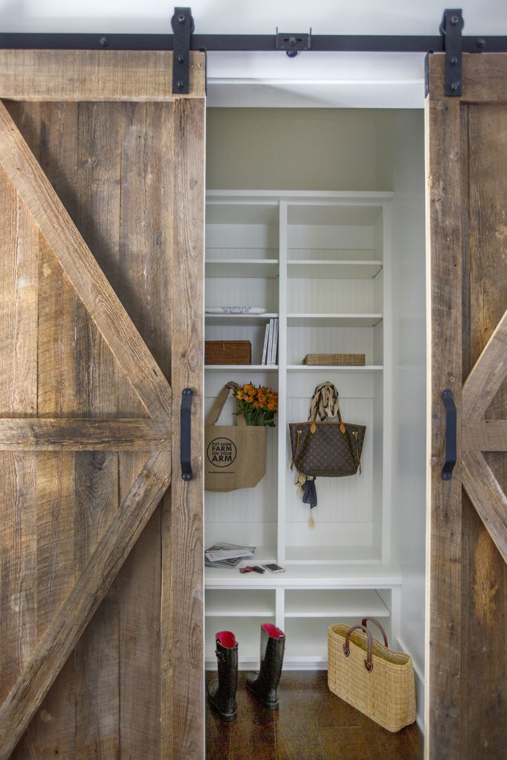 90 best barn doors images on pinterest sliding barn doors a barn wood door slides open to reveal a mudroom filled with white beadboard built in lockers fitted with shelves eventelaan Gallery