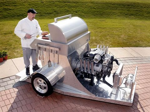 """Tim Kowalec built this HEMI-powered BBQ grill for Chrysler's """"What Can You HEMI?"""" contest in 2005. Tim's """"manly man's barbecue grill"""" featured a 5.7-liter V-8 HEMI engine, and can cook 240 hot dogs in 3 minutes!"""