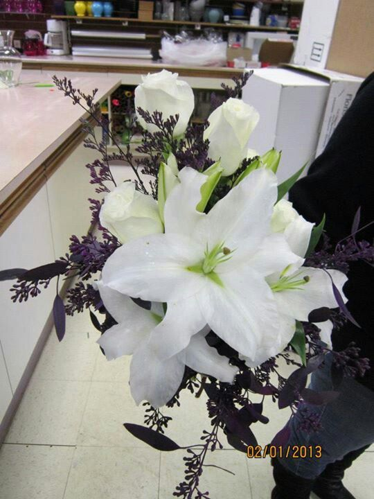 White lilies and white roses with purple accent Bridal bouquet