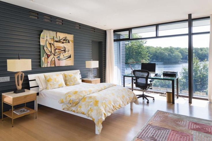 Wrapped in walls of glass, this stylish home on Blue Heron Lake offers a gorgeous view from every room.