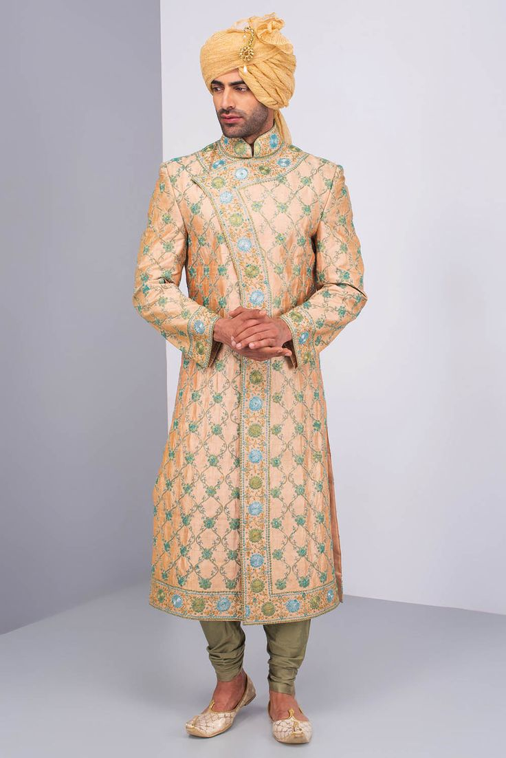PRIYA CHHABRIA Peach Cross- Over Style Sherwani With All- Over Jaal Embroidery IS Paired With A Silk Green Chudidar. #flyrobe #groom #groomwear #groomsherwani #sherwani #flyrobe #wedding #designersherwani
