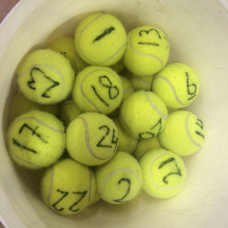 Put letters on tennis balls